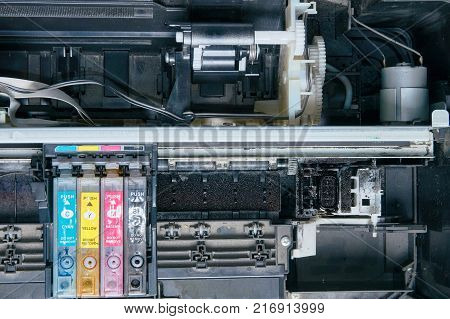 Old dirty disassembled ink jet printer. View of internal parts. Closeup