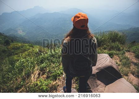 Asian women travel relax in the holiday. Stand and watch landscape on the Moutain. Mountain Park happily. In Thailand
