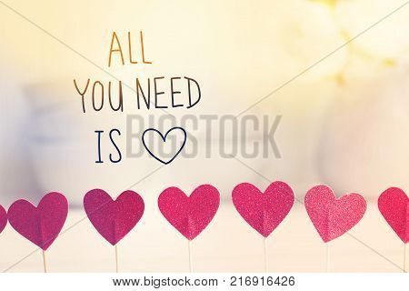 All You Need Is Love message with small red hearts with white dishes