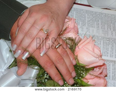 Wedding Hands With Bible
