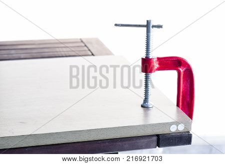Use C-clamp holding wood attach the table to steady or not move before work