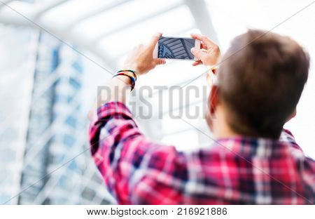 Young Man Taking Photo Smartphone Concept