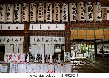 Kanazawa - Japan, June 9, 2017: Interior of the Oyama jinja Shrine with lanterns and bottles of sake as a gift to the shrine