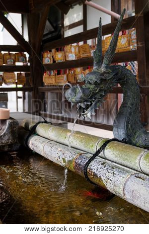 Nara, Japan -  May 30, 2017: A Japanese water dragon at a water pavilion at a Shinto shrine in Nara to purify your hands and mouth