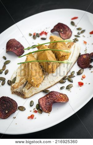 gourmet fusion cuisine fish fillet with spicy curry mashed pumpkin meal