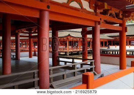 Miyajima - Japan, May 26, 2017: Long corridors and pillars at the famous the Itsukushima Shrine on Miyajima