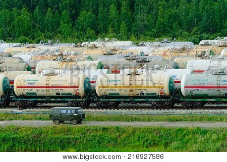Tobolsk, Russia - July 15. 2016: Sibur company. Denisovka railway station. Tanks with fuel being transported by rail