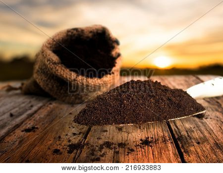 Soil for planting with soil bag over sunset background