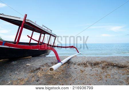 Traditional fishing boat trimaran in Bali, Indonesia. Stock image.