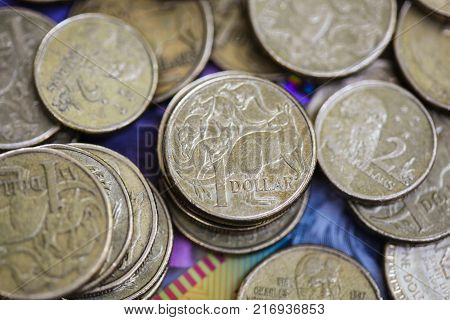Australian one and two dollar coins financial background.