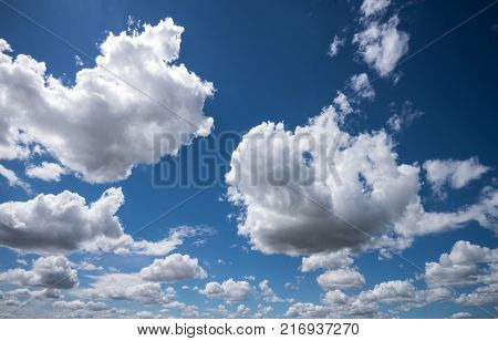white clouds. in the background a blue sky. beautiful landscape in nature. symbolic photo for climate protection, climate change and environmental protection.