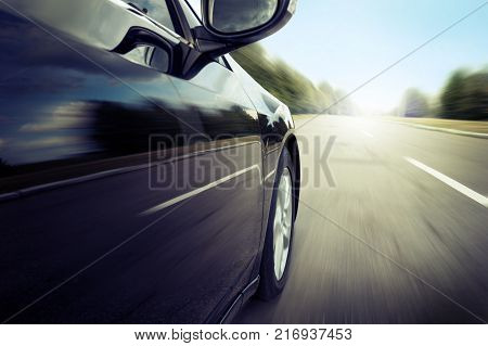 Blurred road and car. Speed motion blur