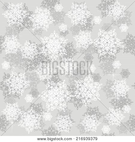 Seamless pattern with grey and white snowflakes