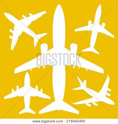 white jet airliners in the air isolated on yellow background