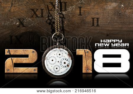 Happy New Year 2018 - Wooden numbers with an old and broken pocket watch with chain on a wooden background
