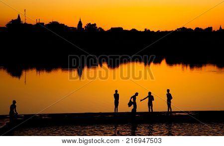 Indigenous Indian boys washing by the lake.