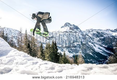 Snowboarder performing tricks on the snow and jumping