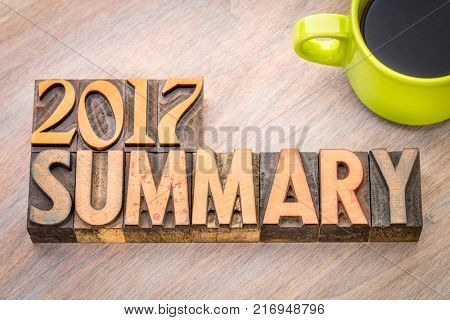2017 summary word abstract in vintage letterpress wood type with a cup of coffee