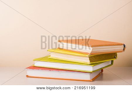 Stack of colorful books. Education background. Copy space for text.