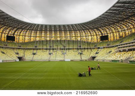 GDANSK / POLAND: Football stadium - Workers are cultivating the turf of the football field