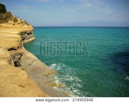 Sidari Corfu Greece - June 08 2013 : Tourists having fun at Canal d'amour on Corfu - Kerkyra island - Sidari beach
