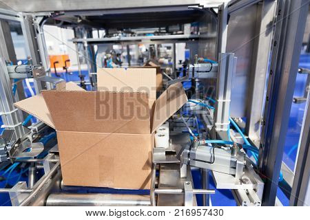 poster of Automatic cardboard package box erector and packing machine