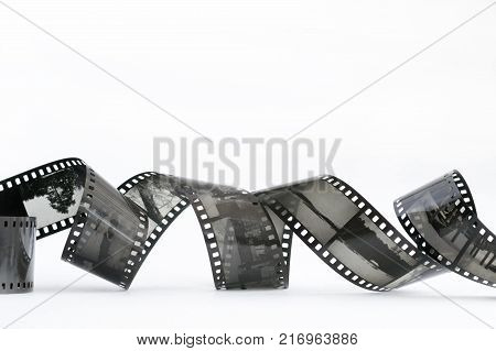 black and white slide film on a white background twisted into a spiral