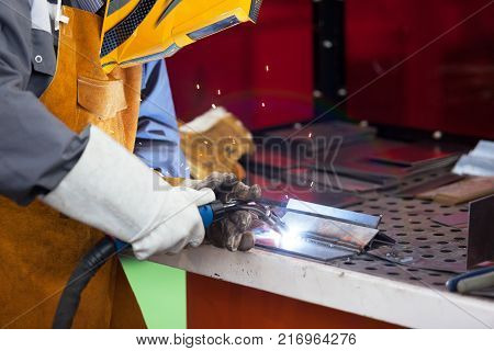 Welding. Welder with protective mask welding metal.