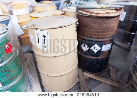 Old rusty barrels with toxic chemical waste