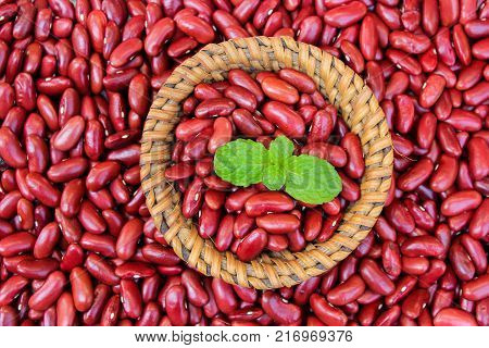 Red kidney bean on rattan cup on red kidney bean background