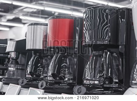 In the shop of home appliances on display are the modern drip coffee makers.