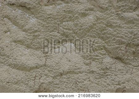 gray texture of sand in a pile on the street