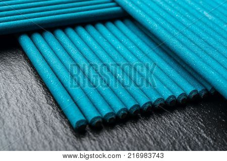 Electrodes for welding, on a black background poster