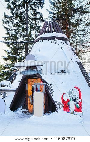 Suomi traditional house at Santa Claus Office Santa Village in Finnish Lapland Scandinavia on Arctic Circle in winter. poster