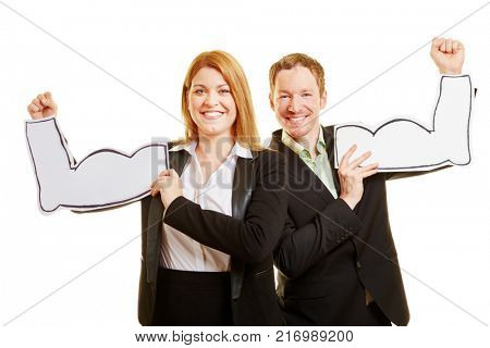 Business couple as a very motivated team with mussles made of paper on their arms