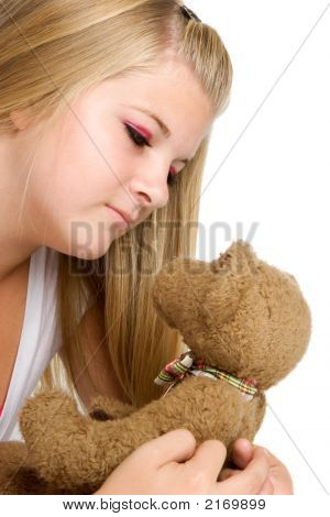 Cute young blonde girl with teddy bear poster