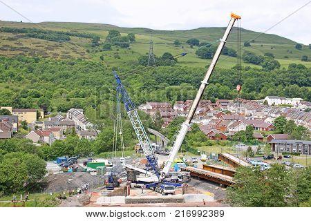 Crane lifting a beam for a new bridge