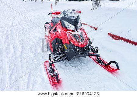 Rovaniemi Finland - March 2 2017: Red snowmobile in frozen lake at winter Rovaniemi in Lapland Finland
