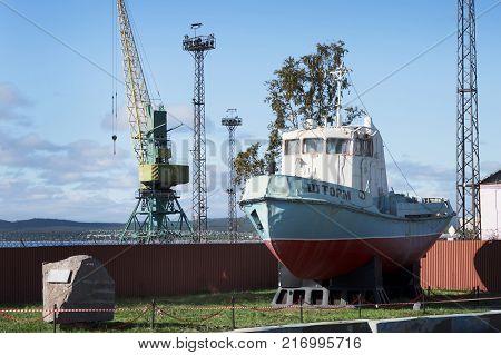 Tugboat As A Monument Near Port. Kandalaksha