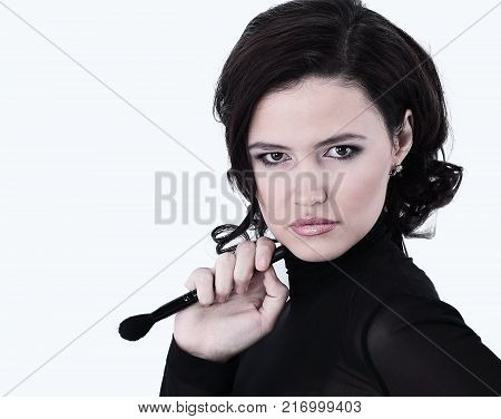 smiling young woman with brush for makeup.photo with copy space