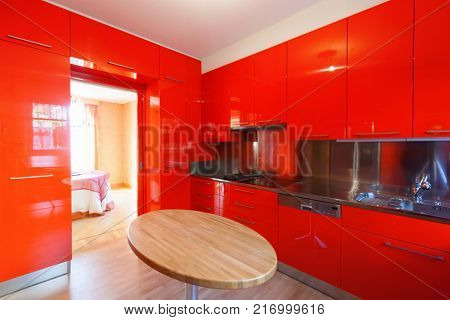 Modern wide kitchen lacquered red, modern wood table