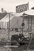 Civil war soldier resting under the confederate flag poster