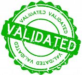 Grunge green validated wording round rubber seal stamp on white background poster