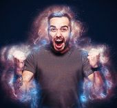 Angry young man standing in flames, shouting. Illustration of fury and madness. poster