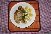 Two Fish Fillets with onion and lemon slices as a healthy meal poster