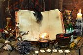 Old witch book with empty pages, lavender flowers, pentagram and witchcraft objects. Occult, esoteric, divination and wicca concept. Mystic and vintage background poster