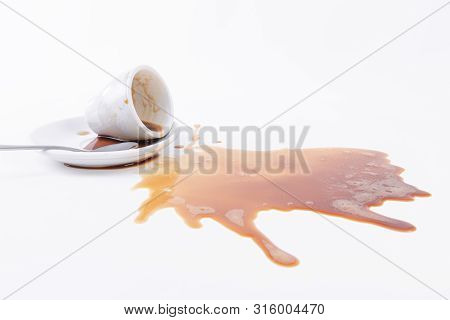 A Cup Of Spilled Coffee On A White Background