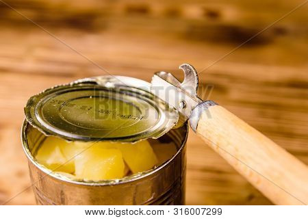 Opening Of Aluminium Tin Can With Chopped Canned Pineapple
