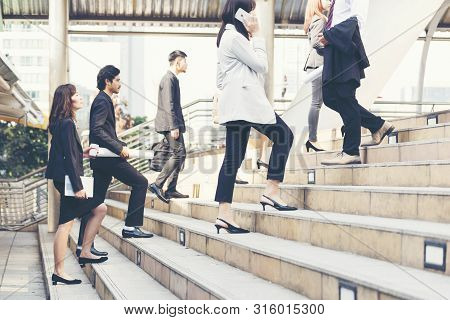 Young Active Business People Walking Up Stair To Go To Work In Modern City. Crowded Group Of People