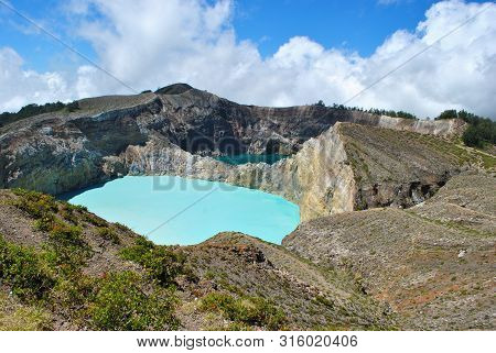 View Of The Two Of The Three Tri-colored Lakes On The Peak Of Ganung Kelimutu National Park In Flore